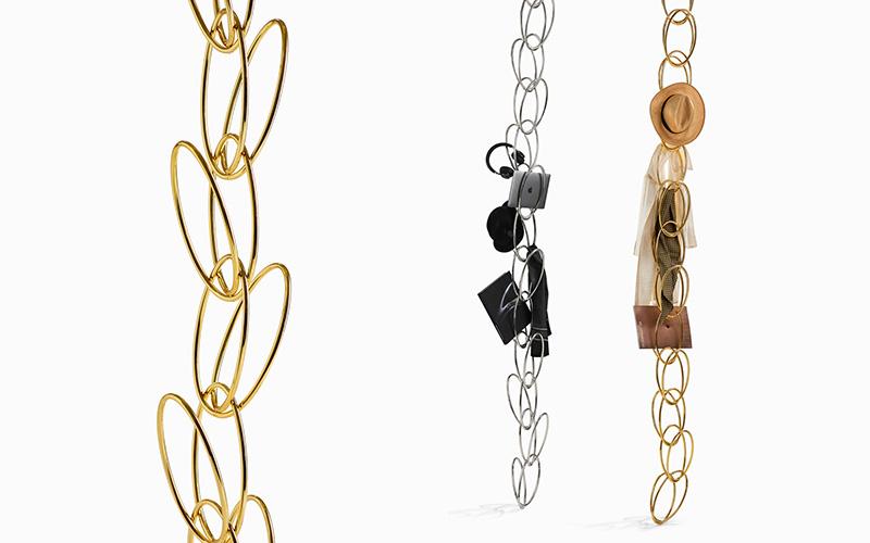 Appendiabiti e portaoggetti SenzaTempo di Opinion Ciatti realizzato in acciaio, con finitura cromo oppure oro.