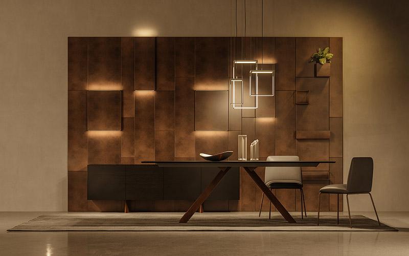 Boiserie Magnetika di Ronda Design ambientata in salotto con pareti tinta scura, tavolo e sedie